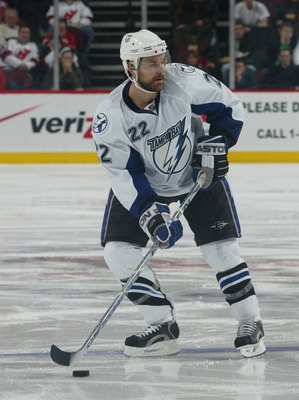 NEWARK, NJ - MARCH 07: Dan Boyle #22 of the Tampa Bay Lightning skates against the New Jersey Devils on March 7, 2008 at the Prudential Center in Newark, New Jersey. The Devils defeated the Lightning 2-1. (Photo by Bruce Bennett/Getty Images)