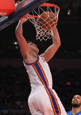 NEW YORK, NY - FEBRUARY 02:  Danilo Gallinari #8 of the New York Knicks dunks the ball against the Dallas Mavericks at Madison Square Garden on February 2, 2011 in New York City. NOTE TO USER: User expressly acknowledges and agrees that, by downloading an