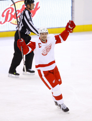 OTTAWA, ON - FEBRUARY 02:  Nicklas Lidstrom #5 of the Detroit Red Wings celebrates a teammates goal against the Ottawa Senators in a game at Scotiabank Place on February 2, 2011 in Ottawa, Canada.  (Photo by Phillip MacCallum/Getty Images)