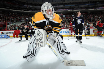 RALEIGH, NC - JANUARY 29:  Tim Thomas #30 of the Boston Bruins looks on during the Honda NHL SuperSkills competition part of 2011 NHL All-Star Weekend at the RBC Center on January 29, 2011 in Raleigh, North Carolina.  (Photo by Harry How/Getty Images)