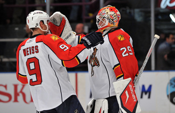 NEW YORK, NY - JANUARY 25: Tomas Vokoun #29 of the Florida Panthers is congratulated by Stephen Weiss #9 after defeating the New York Rangers 4-3 at Madison Square Garden on January 25, 2011 in New York City. The Panthers defeated the 4-3. (Photo by Chris