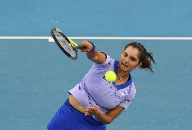 HOBART, AUSTRALIA - JANUARY 11:  Sania Mirza of India serves in her first round match against Alicia Molik of Australia during day four of the Moorilla Hobart International 2010 at Domain Tennis Centre on January 11, 2010 in Hobart, Australia.  (Photo by