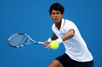 MELBOURNE, AUSTRALIA - JANUARY 17:  Somdev Devvarman of India plays a forehand in his first round match against Tommy Robredo of Spain during day one of the 2011 Australian Open at Melbourne Park on January 17, 2011 in Melbourne, Australia.  (Photo by Cli