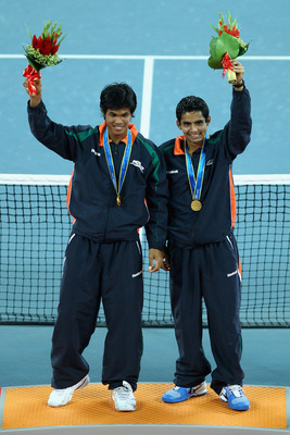 GUANGZHOU, CHINA - NOVEMBER 22:  Devvarman Sk and Sanam Krishan Singh of India celebrate winning the gold medal during the medal ceremony of the Men's Doubles Final tennis match at Aoti Tennis Centre during day ten of the 16th Asian Games Guangzhou 2010 o