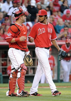 ANAHEIM, CA - MAY 15:  Ervin Santana #54 and Mike Napoli #44 of the Los Angeles Angels talk after a run scored by the Oakland Athletics at Angels Stadium on May 15, 2010 in Anaheim, California.  (Photo by Harry How/Getty Images)