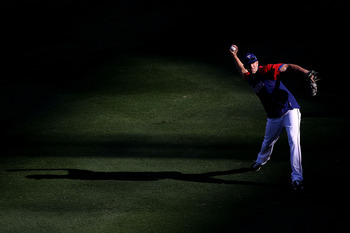 ARLINGTON, TX - NOVEMBER 01:  Darren O'Day of the Texas Rangers warms up against of the San Francisco Giants in Game Five of the 2010 MLB World Series at Rangers Ballpark in Arlington on November 1, 2010 in Arlington, Texas.  (Photo by Christian Petersen/