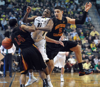 EUGENE, OR - JANUARY 13: Donte Smith (14) and Nikola Vucevic (5) of the USC Trojans pressure Johnathan Loyd (10) of the Oregon Ducks during the second half of the game at Matthew Knight Arena on January 13, 2011 in Eugene, Oregon. Oregon won the game 68-6