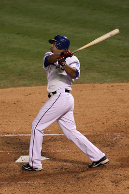 ARLINGTON, TX - NOVEMBER 01:  Nelson Cruz #17 of the Texas Rangers hits a solo home run in the seventh inning against the San Francisco Giants in Game Five of the 2010 MLB World Series at Rangers Ballpark in Arlington on November 1, 2010 in Arlington, Tex