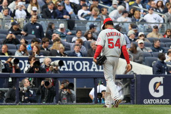NEW YORK - APRIL 13:  Starting pitcher Ervin Santana #54 of the Los Angeles Angels of Anaheim walks towards the dugout after he was taken out of the game in the bottom of the sixth inning against the New York Yankees during the Yankees home opener at Yank