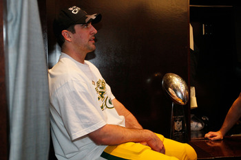 ARLINGTON, TX - FEBRUARY 06:  Super Bowl MVP Aaron Rodgers #12 of the Green Bay Packers celebrates in the locker room with the Vince Lombardi Trophy after the Green Bay Packers defeated the Pittsburgh Steelers 31 to 25 in Super Bowl XLV at Cowboys Stadium