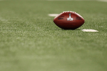 ARLINGTON, TX - FEBRUARY 06:  The game ball sits on the field as the Green Bay Packers play against the Pittsburgh Steelers during Super Bowl XLV at Cowboys Stadium on February 6, 2011 in Arlington, Texas.  (Photo by Ronald Martinez/Getty Images)