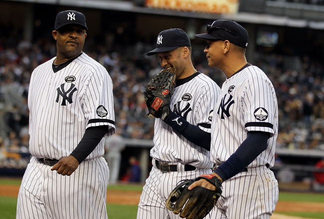 NEW YORK - OCTOBER 20:  (L-R)  CC Sabathia #52, Derek Jeter #2 and Alex Rodriguez #13 of the New York Yankees walk back to the dugout at the end of the top of the fourth inning against the Texas Rangers in Game Five of the ALCS during the 2010 MLB Playoff