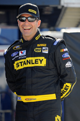DAYTONA BEACH, FL - JANUARY 22:  Marcos Ambrose, driver of the #9 Stanley Ford, shares a laugh in garage during testing at Daytona International Speedway on January 22, 2011 in Daytona Beach, Florida.  (Photo by Jared C. Tilton/Getty Images for NASCAR)