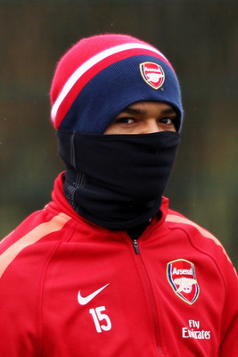 ST ALBANS, ENGLAND - DECEMBER 15:  Denílson covers up from the cold weather during the Arsenal Training Session at London Colney on December 15, 2010 in St Albans, England.  (Photo by Dean Mouhtaropoulos/Getty Images)