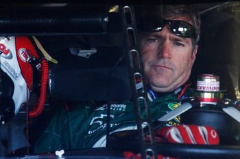 FORT WORTH, TX - NOVEMBER 06:  Bobby Labonte, driver of the #10 Gander Mountain Outdoors Chevrolet, sits in his car in the garage area during practice for the NASCAR Sprint Cup Series AAA Texas 500 at Texas Motor Speedway on November 6, 2010 in Fort Worth