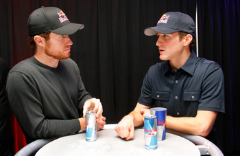 CHARLOTTE, NC - JANUARY 25:  Brian Vickers (L), driver of the #83 Red Bull Toyota, speaks with Kasey Kahne, driver of the #4 Red Bull Toyota, during the NASCAR Sprint Media Tour hosted by Charlotte Motor Speedway, held at Hilton University on January 25,