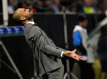MILAN, ITALY - APRIL 20:  Barcelona head coach Josep Guardiola reacts during the UEFA Champions League Semi Final First Leg match between Inter Milan and Barcelona at Giuseppe Meazza Stadium on April 20, 2010 in Milan, Italy.  (Photo by Claudio Villa/Gett