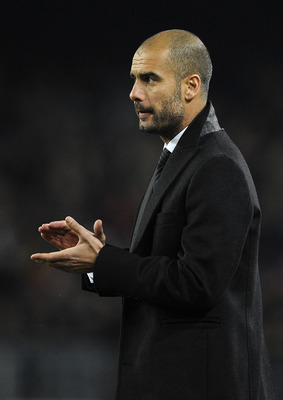 BARCELONA, SPAIN - DECEMBER 12:  Head coach Josep Guardiola of Barcelona claps his hands during the La Liga match between Barcelona and Real Sociedad at Camp Nou Stadium on December 12, 2010 in Barcelona, Spain. Barcelona won the match 5-0.  (Photo by Dav