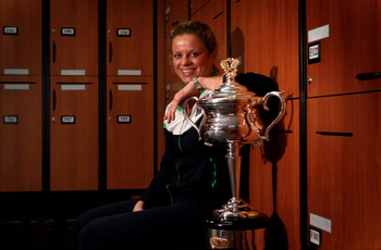 MELBOURNE, AUSTRALIA - JANUARY 29:  Kim Clijsters of Belgium poses with the Daphne Akhurst Trophy in the changing room after winning her women's final match against Na Li of China during day thirteen of the 2011 Australian Open at Melbourne Park  on Janua