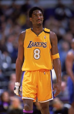 5 Dec 1999:  Kobe Bryant #8 of the Los Angeles Lakers looks on from the court during the game against the Orlando Magic at the Staples Center in Los Angeles, California. The Lakers defeated the Magic 117-100.   Mandatory Credit: Donald Miralle  /Allsport