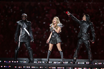 ARLINGTON, TX - FEBRUARY 06:  will.i.am, Fergie and Taboo of The Black Eyed Peas perform during the Bridgestone Super Bowl XLV Halftime Show at Dallas Cowboys Stadium on February 6, 2011 in Arlington, Texas.  (Photo by Christopher Polk/Getty Images)