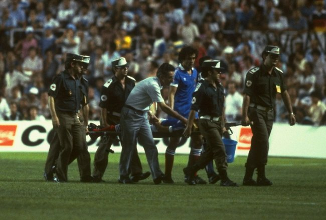 8 Jul 1982:  Battiston of France is stretchered off after a tackle by Harald Schumacher of West Germany during the 1982 World Cup semi-final match at Sanchez Pizjuan in Seville, Spain. The match ended in a 3-3 draw.  \ Mandatory Credit: Steve  Powell/Alls