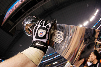 ARLINGTON, TX - FEBRUARY 06:  The Vince Lombardi Trophy is help up after the Green Bay Packers won Super Bowl XLV against the Pittsburgh Steelers at Cowboys Stadium on February 6, 2011 in Arlington, Texas.  (Photo by Kevin C. Cox/Getty Images)