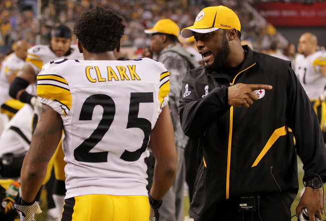 ARLINGTON, TX - FEBRUARY 06:  Head coach Mike Tomlin of the Pittsburgh Steelers talks to Ryan Clark #25 of the Pittsburgh Steelers as they play against the Green Bay Packers during Super Bowl XLV at Cowboys Stadium on February 6, 2011 in Arlington, Texas.