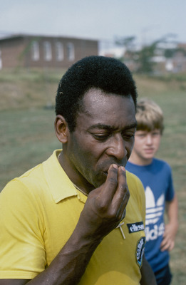 Brazilian footballer Pele kisses his hand during a training session, mid 1970s. (Photo by Duncan Raban/Getty Images)