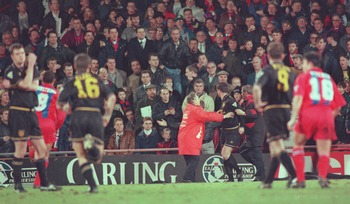 25 JAN 1995:  ERIC CANTONA OF MANCHESTER UNITED IS INVOLVED IN A FIGHT WITH A FAN AFTER HE WAS SENT OFF DURING THE CRYSTAL PALACE V MANCHESTER UNITED MATCH AT SELHURST PARK. Mandatory Credit: Shaun Botterill/ALLSPORT