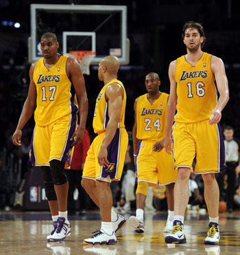 LOS ANGELES, CA - FEBRUARY 03:  Pau Gasol #16, Andrew Bynum #17, Kobe Bryant #24 and Derek Fisher #2 of the Los Angeles Lakers head to the bench after a time out trailing the San Antonio Spurs during the second half at Staples Center on February 3, 2011 i