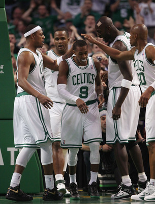 BOSTON, MA - FEBRUARY 06:  Rajon Rondo #9 of the Boston Celtics is congratulated by teammates Paul Pierce #23,Glen Davis #11,Kevin Garnett #5 and Ray Allen #20 after Rondo drew the foul in the second half agianst the Orlando Magic on February 6, 2011 at t