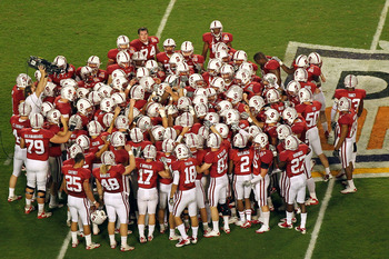 MIAMI, FL - JANUARY 03:  The Stanford Cardinal huddle on the field prior to playing against the Virginia Tech Hokies during the 2011 Discover Orange Bowl at Sun Life Stadium on January 3, 2011 in Miami, Florida. Stanford won 40-12. (Photo by Mike Ehrmann/