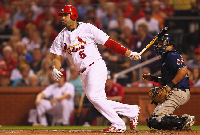 ST. LOUIS - SEPTEMBER 17: Albert Pujols #5 of the St. Louis Cardinals hits an RBI double against the San Diego Padres at Busch Stadium on September 17, 2010 in St. Louis, Missouri.  (Photo by Dilip Vishwanat/Getty Images)