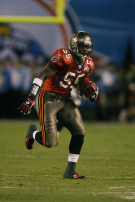 SAN DIEGO - JANUARY 26:  Linebacker Derrick Brooks #55 of the Tampa Bay Buccaneers picks up a fumble by Oakland Raiders quarterback Rich Gannon and runs it in for a fourth quarter touchdown during Super Bowl XXXVII at Qualcomm Stadium on January 26, 2003