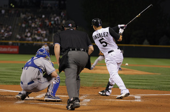 DENVER - SEPTEMBER 27:  Carlos Gonzalez #5 of the Colorado Rockies takes an at bat against the Los Angeles Dodgers at Coors Field on September 25, 2010 in Denver, Colorado. The Dodgers defeated the Rockies 3-1.  (Photo by Doug Pensinger/Getty Images)