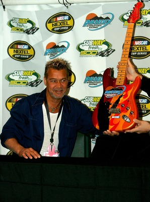 AVONDALE, AZ - APRIL 20:  Musician Eddie Van Halen, who will serve as an honorary race official, poses for pictures with the guitar that will be awarded to the winner of the NASCAR Nextel Cup Series Subway Fresh Fit 500 at Phoenix International Raceway on