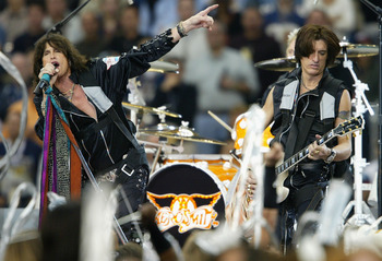HOUSTON, TX - FEBRUARY 1:  Steven Tyler (left) and Joe Perry of Aerosmith perform during the pre-game show prior to the start of Super Bowl XXXVIII between the New England Patriots and the Carolina Panthers at Reliant Stadium on February 1, 2004 in Housto