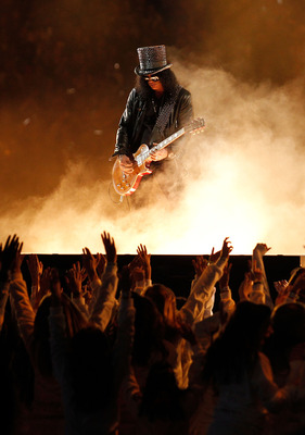 ARLINGTON, TX - FEBRUARY 06:  Slash performs during the Bridgestone Super Bowl XLV Halftime Show at Dallas Cowboys Stadium on February 6, 2011 in Arlington, Texas.  (Photo by Christopher Polk/Getty Images)