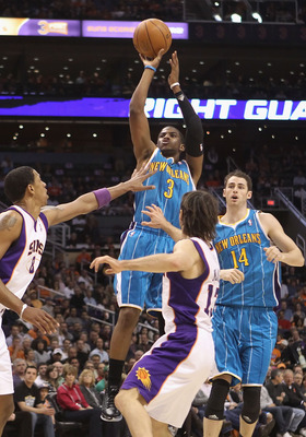 PHOENIX, AZ - JANUARY 30:  Chris Paul #3 of the New Orleans Hornets puts up a shot over Steve Nash #13 and Channing Frye #8 of the Phoenix Suns during the NBA game at US Airways Center on January 30, 2011 in Phoenix, Arizona. The Suns defeated the Hornets