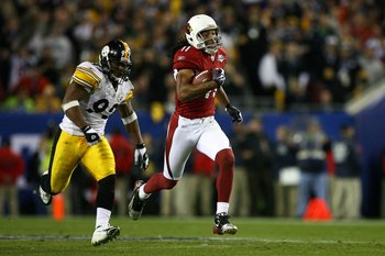 TAMPA, FL - FEBRUARY 01:  Larry Fitzgerald #11 of the Arizona Cardinals runs for yards after the catch on a 64-yard touchdown reception against James Harrison #92 of the Pittsburgh Steelers in the fourth quarter during Super Bowl XLIII on February 1, 2009