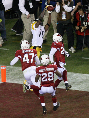 TAMPA, FL - FEBRUARY 01:  Santonio Holmes #10 of the Pittsburgh Steelers catches a touchdown in fourth quarter against Aaron Francisco #47 and Dominique Rodgers-Cromartie #29 of the Arizona Cardinals during Super Bowl XLIII on February 1, 2009 at Raymond