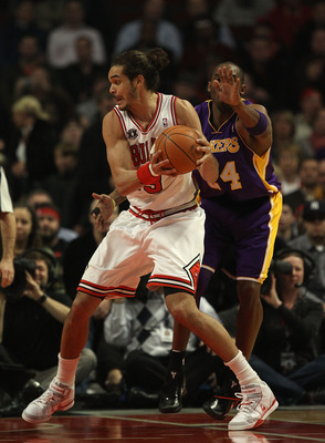 CHICAGO, IL - DECEMBER 10: Joakim Noah #13 of the Chicago Bulls moves past Kobe Bryant #24 of the Los Angeles Lakers at the United Center on December 10, 2010 in Chicago, Illinois. The Bulls defeated the Lakers 88-84. NOTE TO USER: User expressly acknowle