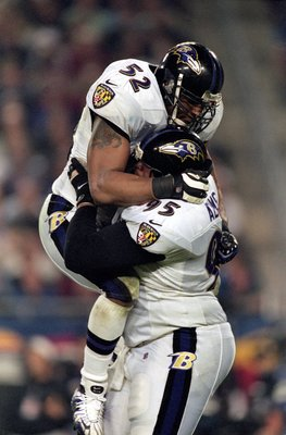 28 Jan 2001:  Ray Lewis #52 of the Baltimore Ravens leaps up and hugs teammate Sam Adams #95 after the Super Bowl XXXV Game against the New York Giants at the Raymond James Stadium in Tampa, Florida. The Ravens defeated the Giants 34-7.Mandatory Credit: A