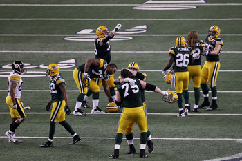 The Packer defense celebrates on the field after Roethlisberger's 4th and 5 pass hits the ground.