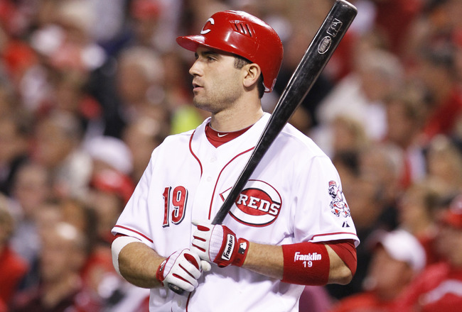 CINCINNATI, OH - SEPTEMBER 28: Joey Votto #19 of the Cincinnati Reds looks on while waiting to bat against the Houston Astros at Great American Ball Park on September 28, 2010 in Cincinnati, Ohio. The Reds won 3-2 to clinch the NL Central Division title.