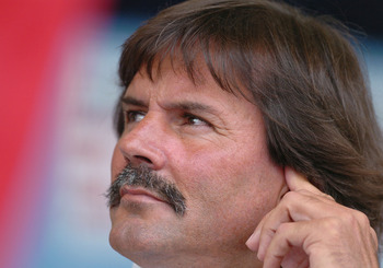 Pitcher Dennis Eckersley listens to speeches  at  2004  Baseball Hall of Fame induction ceremonies  July 25, 2004 in Cooperstown, New York. (Photo by A. Messerschmidt/Getty Images) *** Local Caption ***