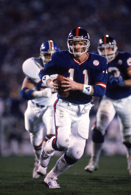 PASADENA, CA - JANUARY 25:  Quarterback Phil Simms #11 of the New York Giants runs with the ball against the Denver Broncos during Super Bowl XXI at the Rose Bowl on January 25, 1987 in Pasadena, California. The Giants defeated the Broncos 39-20. (Photo b
