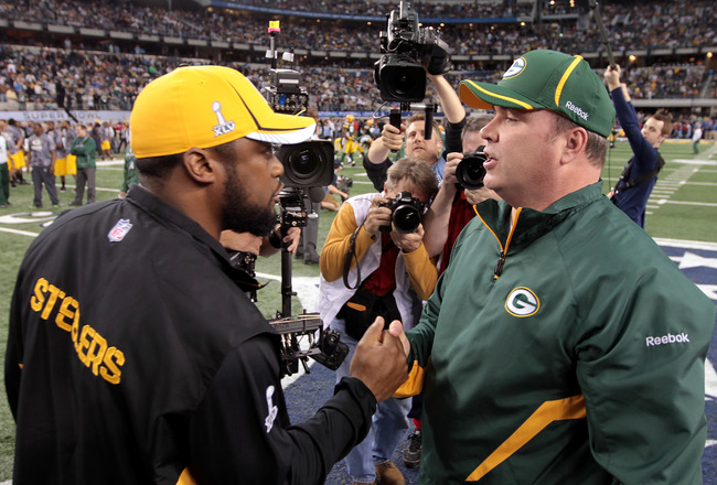 ARLINGTON, TX - FEBRUARY 06: Head coach Mike Tomlin of the Pittsburgh Steelers and head coach Mike McCarthy of the Green Bay Packers speak prior to Super Bowl XLV at Cowboys Stadium on February 6, 2011 in Arlington, Texas.  (Photo by Jamie Squire/Getty Im