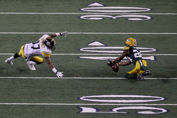 Bush's interception set up a short field for Rodgers and Jennings to connect for six